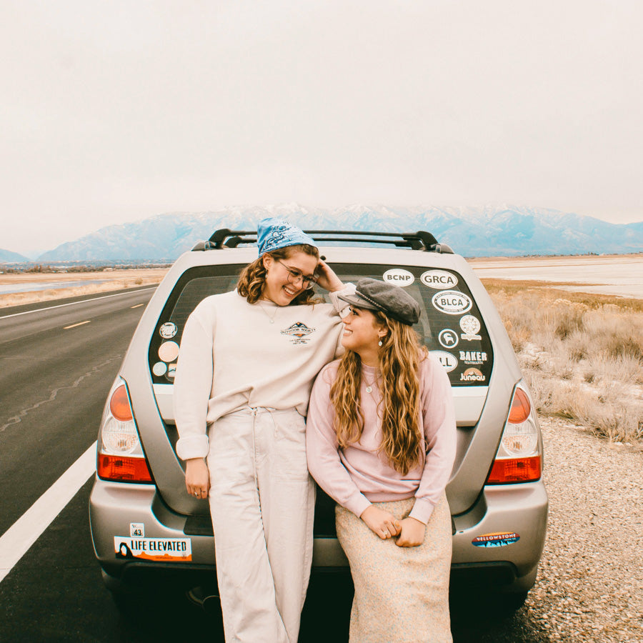 girls on road trip wearing st christopher surf medals