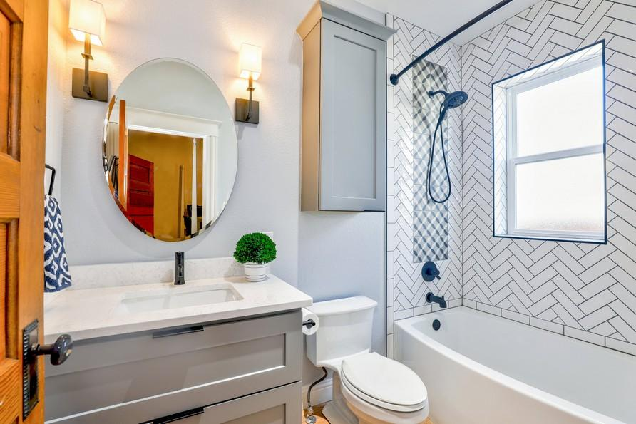 Where should bathroom vanity lights be placed?