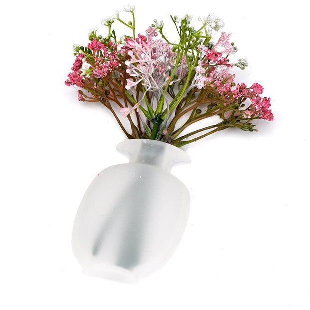 This is a removable silicone vase that can stick to any flat surface