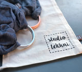 Ring Sling Baby Carrier | denim + rose gold | Studio Tekhni