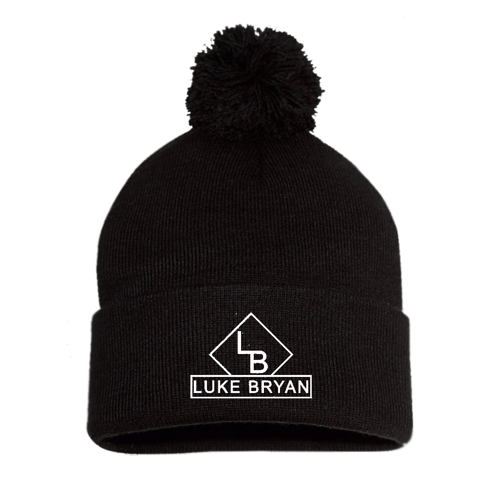 Black beanie with pom pom on top. Luke bryan logo in white on front