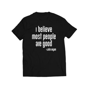 "Black shirt with white lettering that says ""I Believe Most People Are Good"""