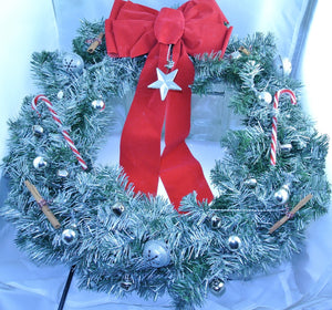 WREATH SILVER RED WHITE CANDY CANES SILVER STAR SILVER BELLS SILVER GLASS ORNAMENTS GLITTER SILVER STAR BELLS SILVER WRAP CINNAMON STICKS RED BOW CHRISTMAS WREATH STARR WILDE STEAMPUNK FORTRESS