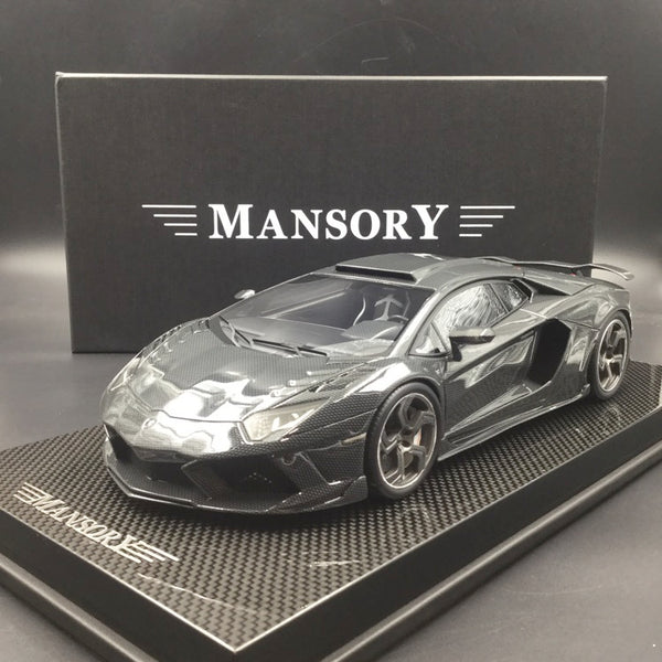 Mansory 1:18 Carbonado Full carbon look  with carbon base and display cover limited 30 pcs  (AC05)