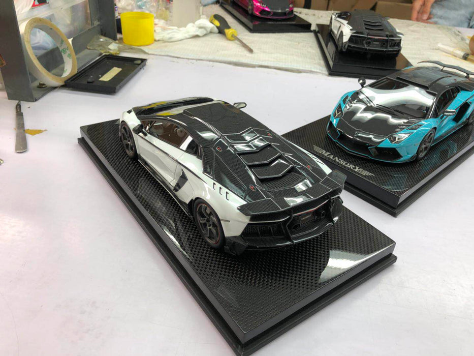 Mansory 1:18 Carbonado Resin in White & Carbon Decor with carbon base and display limited 30 pcs available on May 2018 Pre-order now