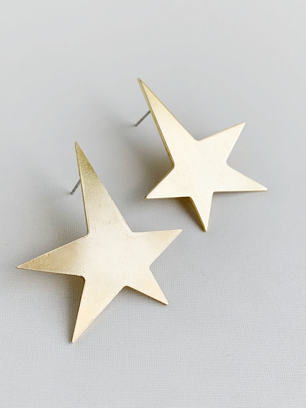 ABSTRACT OVERSIZED GOLD STAR EARRINGS