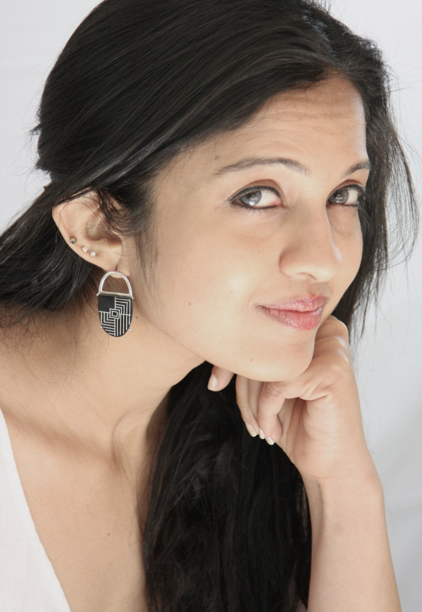 Opulent yet minimalist oval Bidri earrings - Craft Stories
