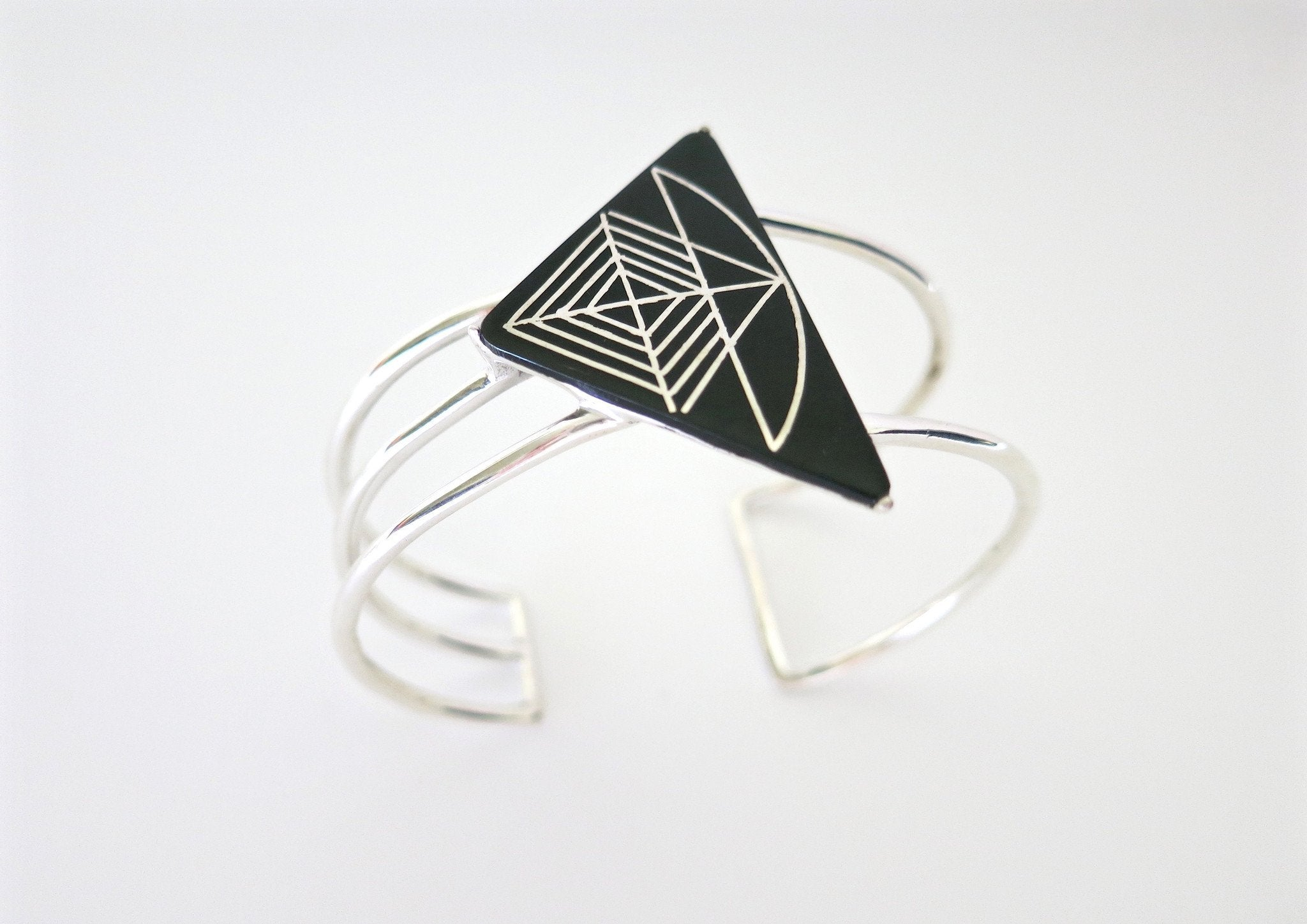 Dramatic triangular Bidri cuff - Craft Stories Handmade, contemporary, personal and home accessories. Designed in California. Handcrafted in India. Traditional craftsmanship meets modern aesthetics. Sustainable design ethos, fair trade, conscious, artisanal jewelry and home decor. Objects with a story. Unique and on-trend.