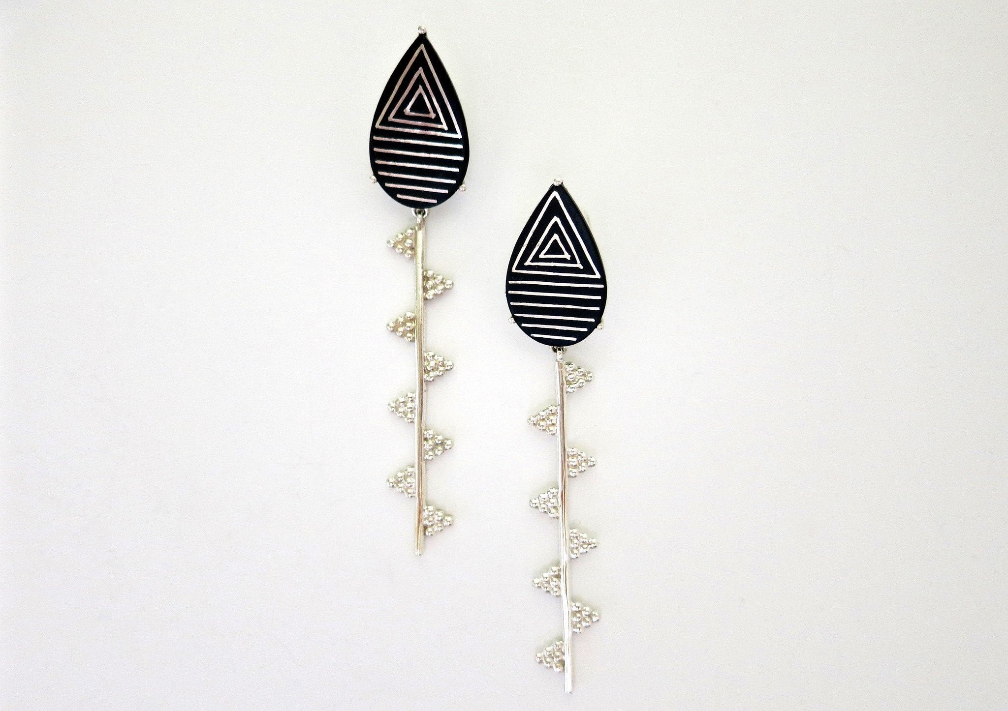 Exquisite, sleek, long Bidri earrings - Craft Stories Handmade, contemporary, personal and home accessories. Designed in California. Handcrafted in India. Traditional craftsmanship meets modern aesthetics. Sustainable design ethos, fair trade, conscious, artisanal jewelry and home decor. Objects with a story. Unique and on-trend.