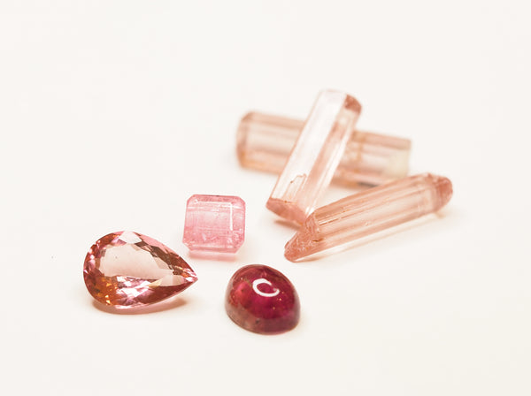 Rough and cut natural tourmalines, a semi-precious gemstone