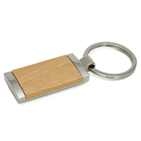 Natural wood and metal key ring laser engraved with your logo. Eco friendly promo key chain