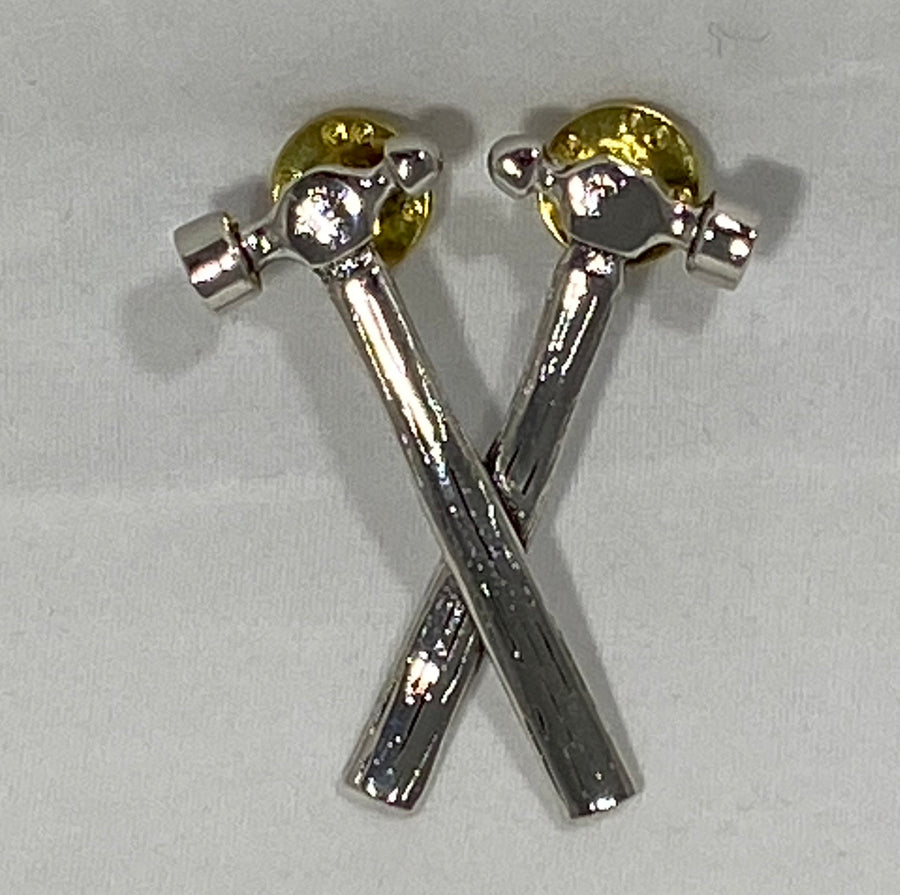 Crossed hammer pins