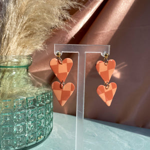ANYA earrings in peach + rust