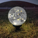 Solar Faerie LED Globe (15 cm) with stake in grass