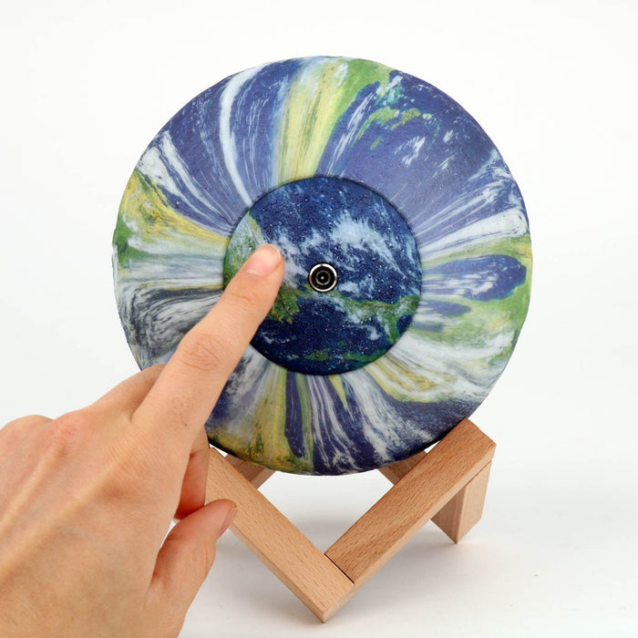 Earth Globe Light with hand pressing on button