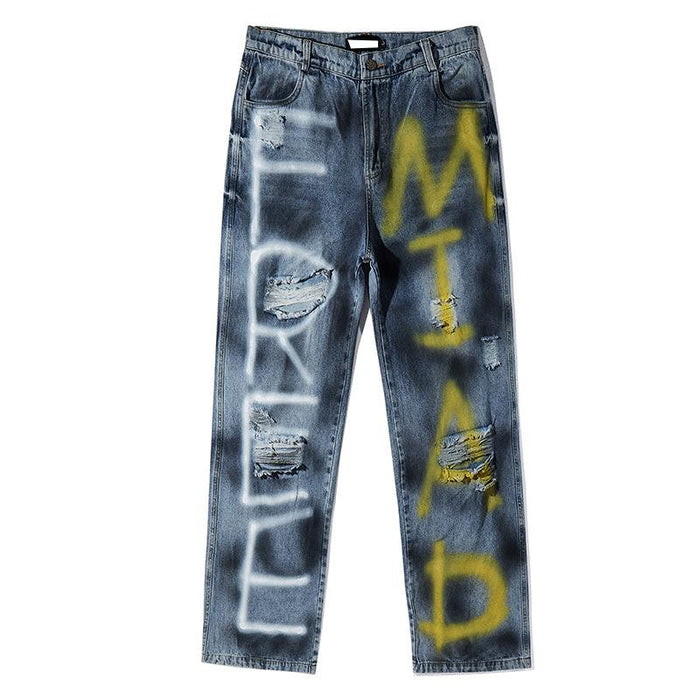 Japanese trendy men spray paint graffiti ripped jeans