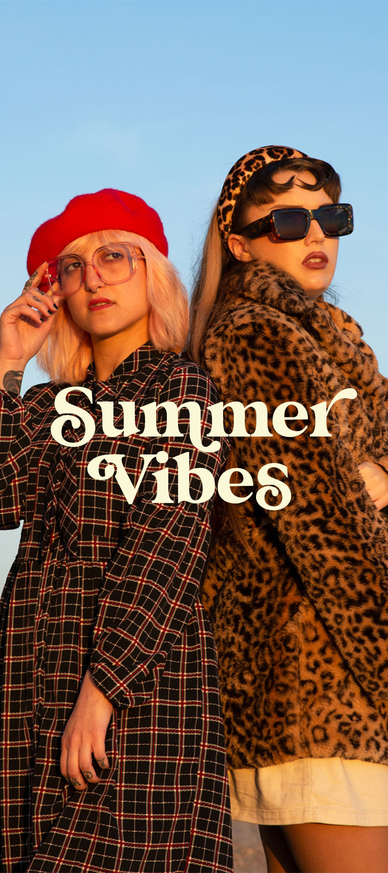 Odysee Summer Vibes - Female Models On Seafront Wearing Aprhodite oversized Retro Blue Light Glasses in Candyfloss and Ray Retro Sunglasses