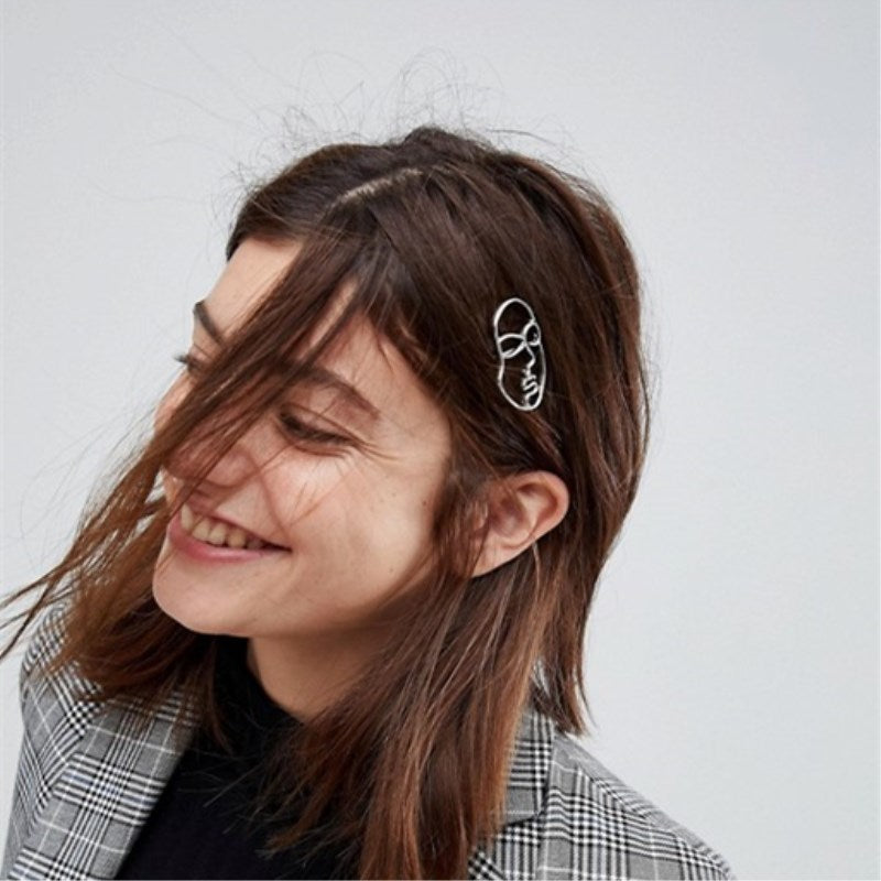 ABSTRACT FACE HAIR CLIP