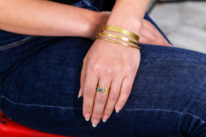 fashion model with moon shaped ring and bangles