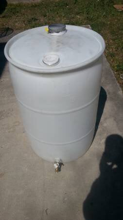 55 GAL. CUSTOM BARREL W/ SPIGOT AND MESH