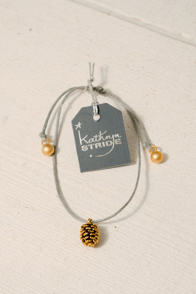 Grey cord Bracelet with Gold Pine Cone metal charm