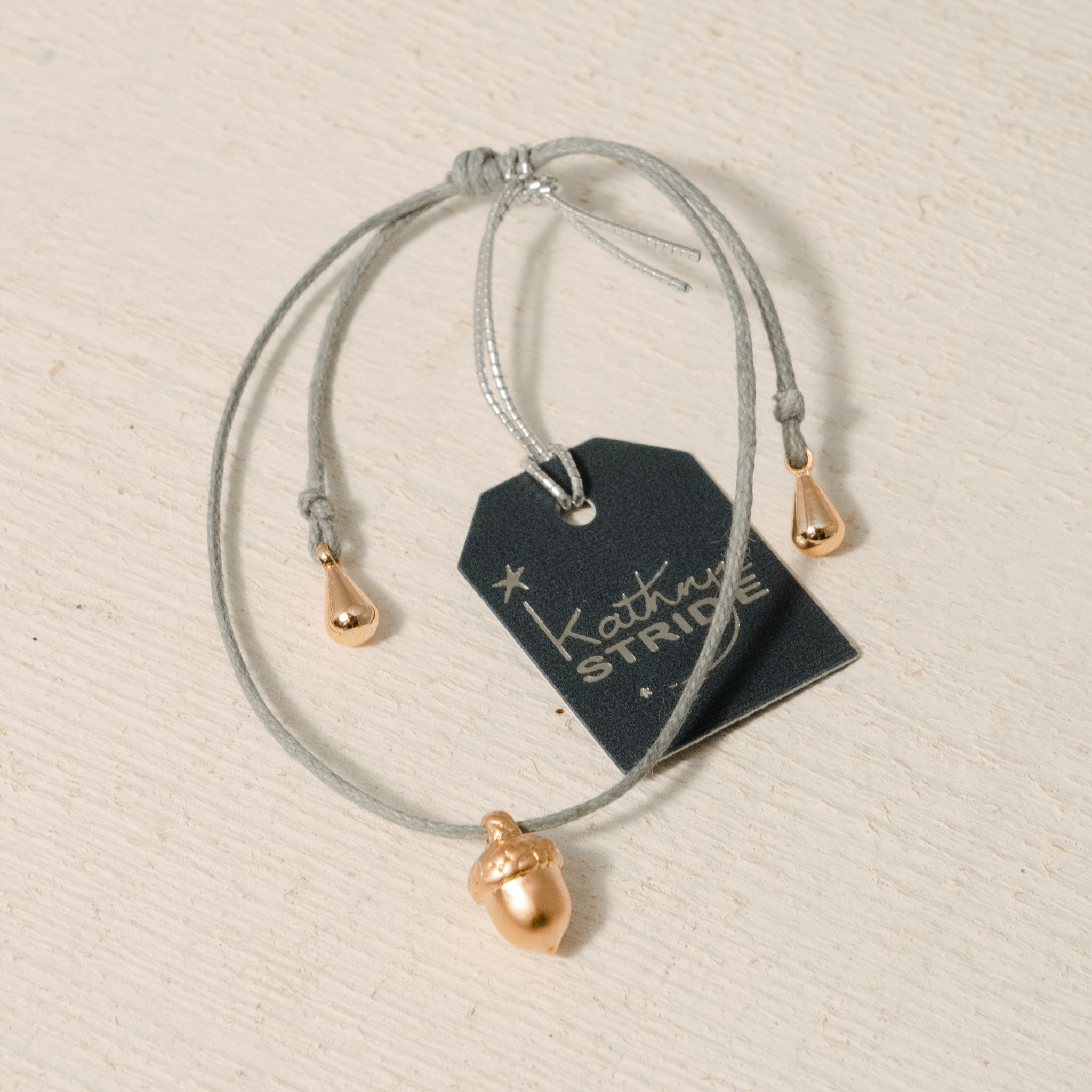 Grey cord Bracelet with Rose Gold Acorn metal charm