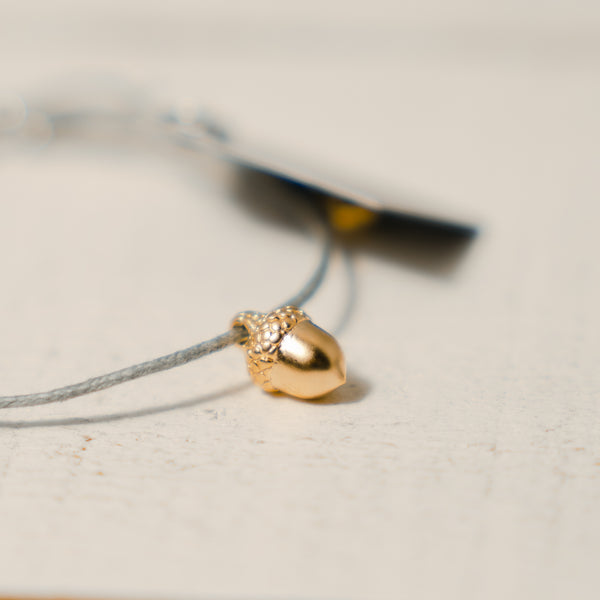 Grey cord Bracelet with Gold Acorn metal charm