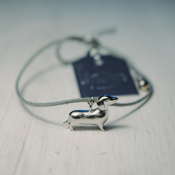 Grey cord Bracelet with tiny Dachshund charm