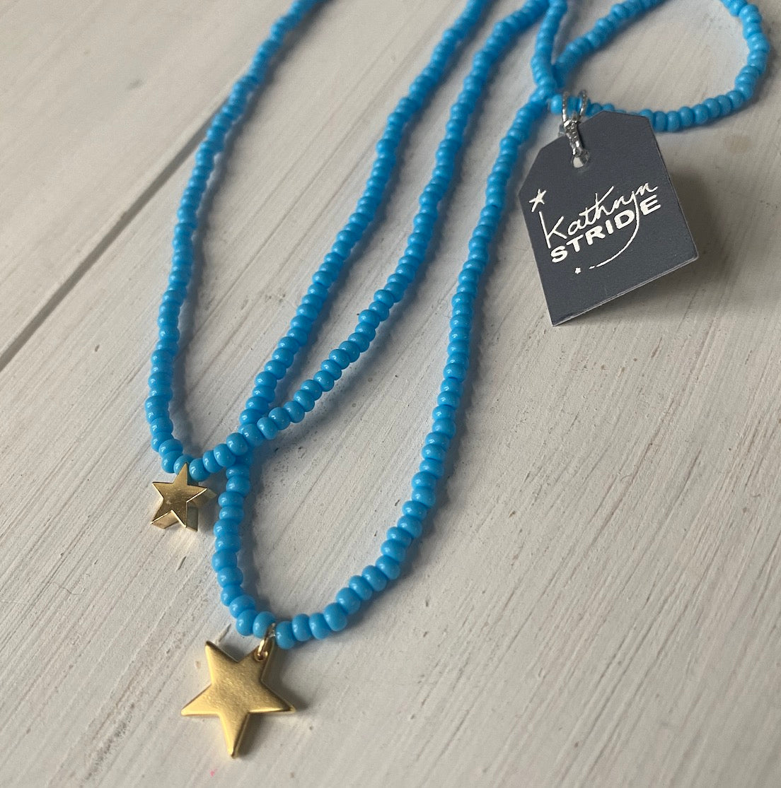 Large Gold Star and vibrant Turquoise Seed Bead Necklace