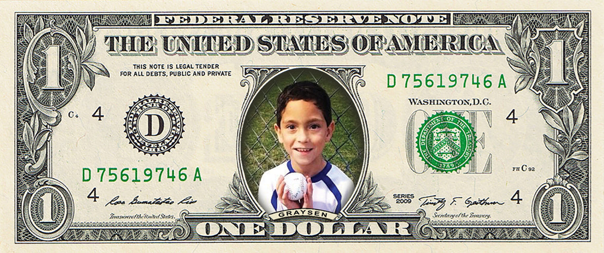 dollar bill from You're on the Money with a picture of a young boy holding a baseball