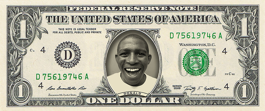 dollar bill from You're on the Money with a picture of a man smiling on it