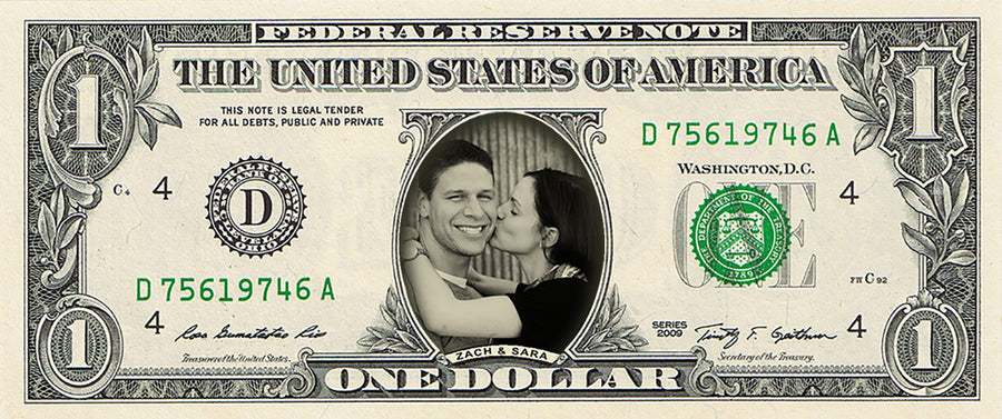 dollar bill from You're on the Money with a picture of a young woman kissing a man on the cheek on it