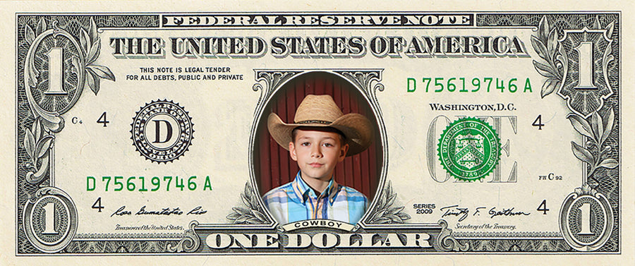 "dollar bill from You're on the Money with a picture of a young boy wearing a cowboy hat on it. The caption on the dollar bill says ""Cowboy"""