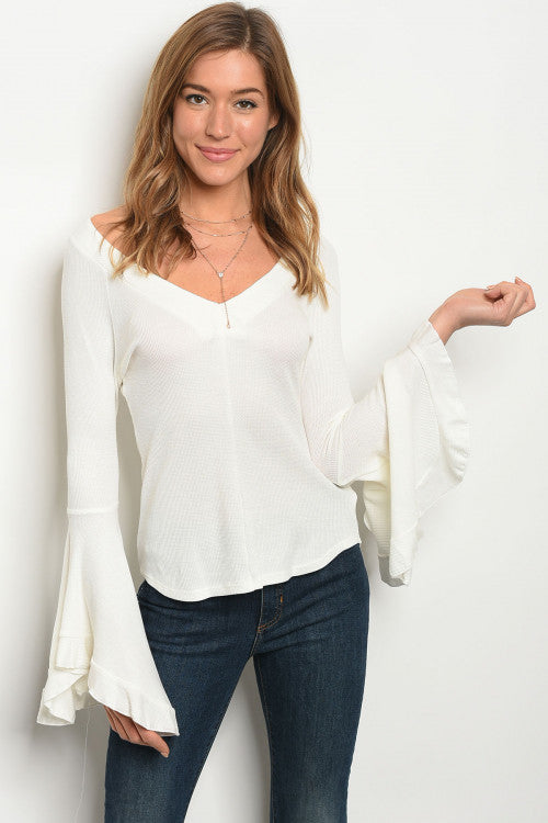 white top with long bell sleeves