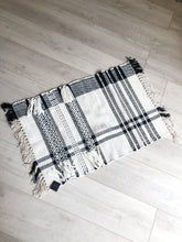 Load image into Gallery viewer, Black and Ivory Loomed Rug