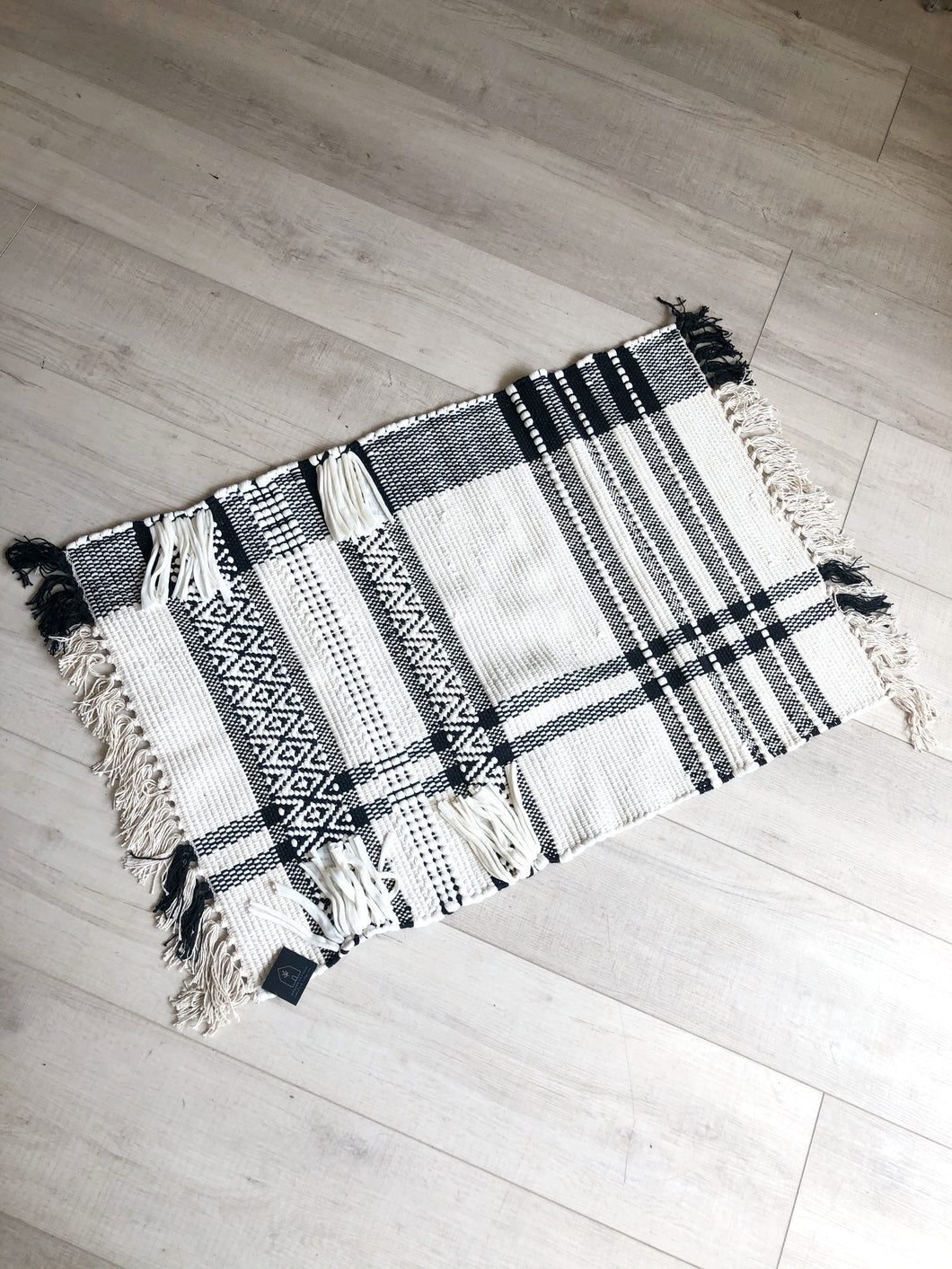 Black and Ivory Loomed Rug