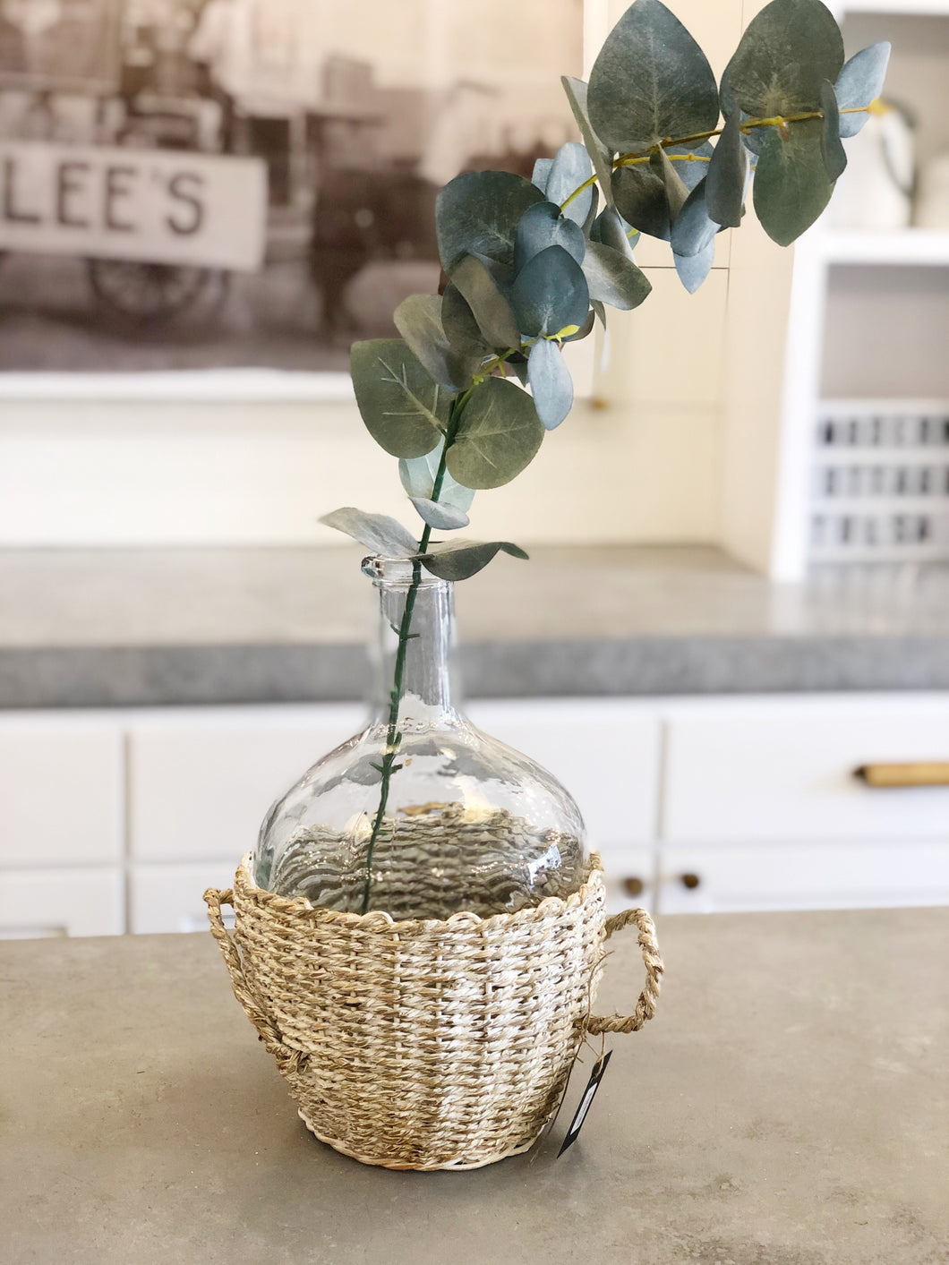 Glass Bottle in Whitewashed Basket