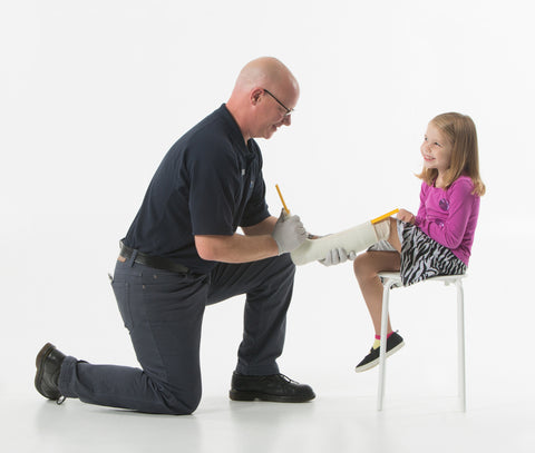 Sean Greer, Certified Licensed Orthotist (CO/LO), is casting Emily for an ankle-foot orthotic.