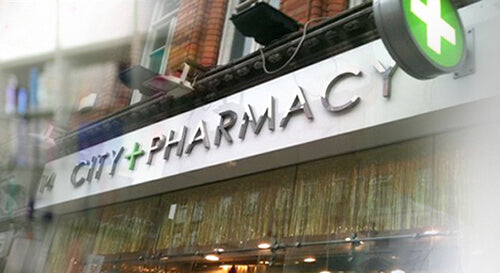 front of city pharmacy shop on about us page