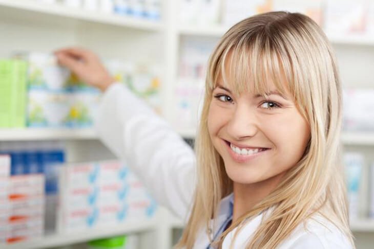 happy pharmacist helping replace lost or forgotten medication