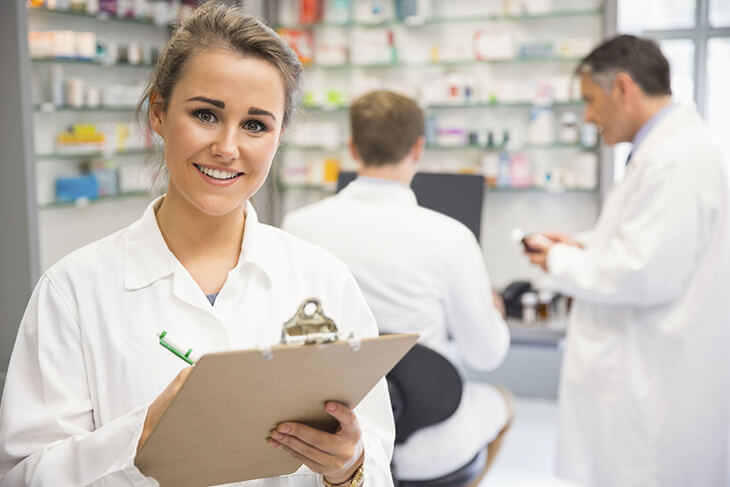 pharmacist with clipboard providing medication use reviews