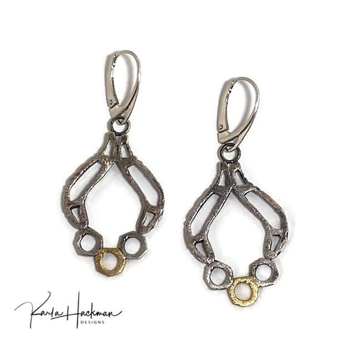 These earrings in sterling silver and 18 karat gold are lightweight,  elements are handcrafted and fabricated, and earrings are given a hammered texture on both faces and a light patina.