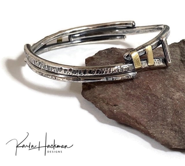 Hand-fabricated and one-of-a-kind, this mixed metal organic bangle in sterling silver and 18 karat gold looks great stacked with other jewelry or worn alone on the wrist. Bracelet is hammer textured with mutliple textures, both faceted and more organic patterns, and given an oxidized finish.