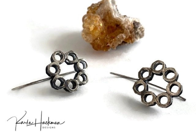 These earrings are solid sterling silver with a hammered finish.  Two layers of honeycomb washer circles are stacked and given an oxidized finish and are hand fabricated with a long sterling silver ear wire.