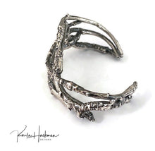 Load image into Gallery viewer, This solid sterling apple branch cuff is created from individually picked branches from Karla's apple tree in Santa Fe.  Once cast branches are fabricated into a solid cuff and given an oxidized finish to highlight their texture.