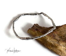 Load image into Gallery viewer, Apple branches from Karla's garden in Santa Fe are picked and cast in sterling silver and then fabricated into individual bangles. Bangles are given an oxidized finish to highlight their beautiful, natural texture.