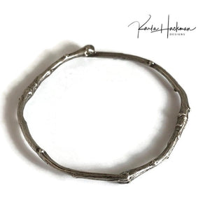 Apple branches from Karla's garden in Santa Fe are picked and cast in sterling silver and then fabricated into individual bangles. Bangles are given an oxidized finish to highlight their beautiful, natural texture.