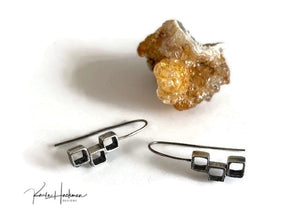 These sterling silver triple stack open cube earrings are such a perfect everyday earring.  Squares are fabricated in a staggered design and textured inside and out and then given an oxidized finish. Features a long ear wire.