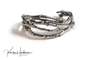 This solid sterling apple branch cuff is created from individually picked branches from Karla's apple tree in Santa Fe.  Once cast branches are fabricated into a solid cuff and given an oxidized finish to highlight their texture.