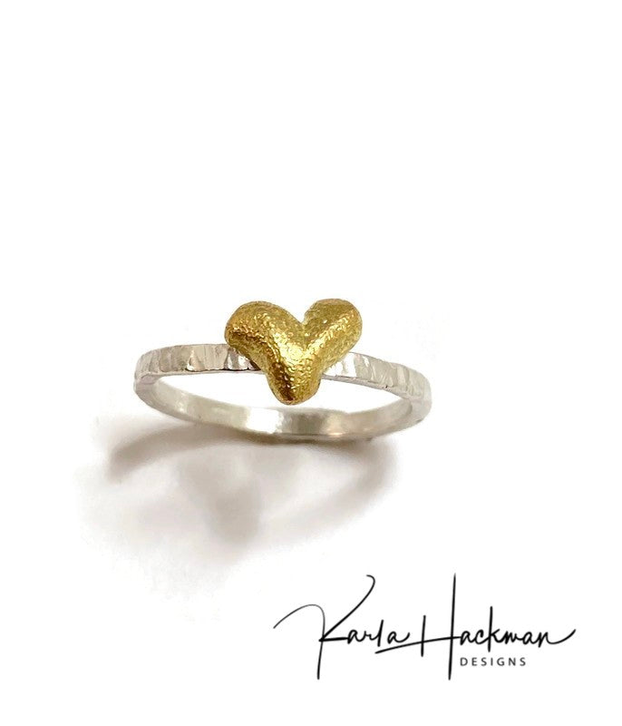 Sterling silver and 18 karat gold are joined in this handcrafted ring, creating this sweet stack ring that is part of the Botanical Collection.  Band is made from sterling silver and heart is carved in wax and cast in 18 karat gold.